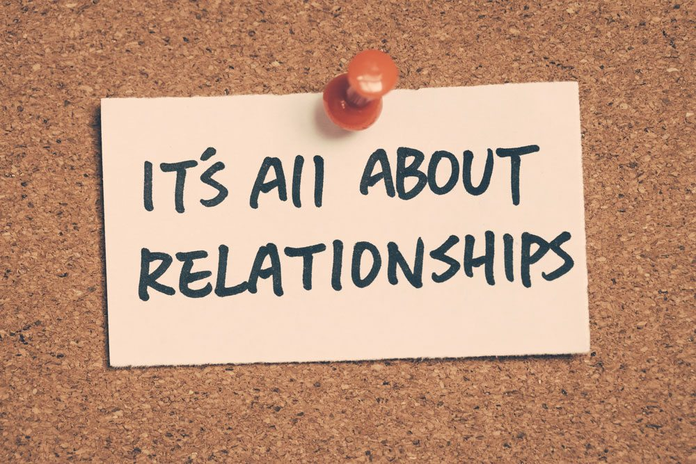 A sticky note that says: It's all about relationships