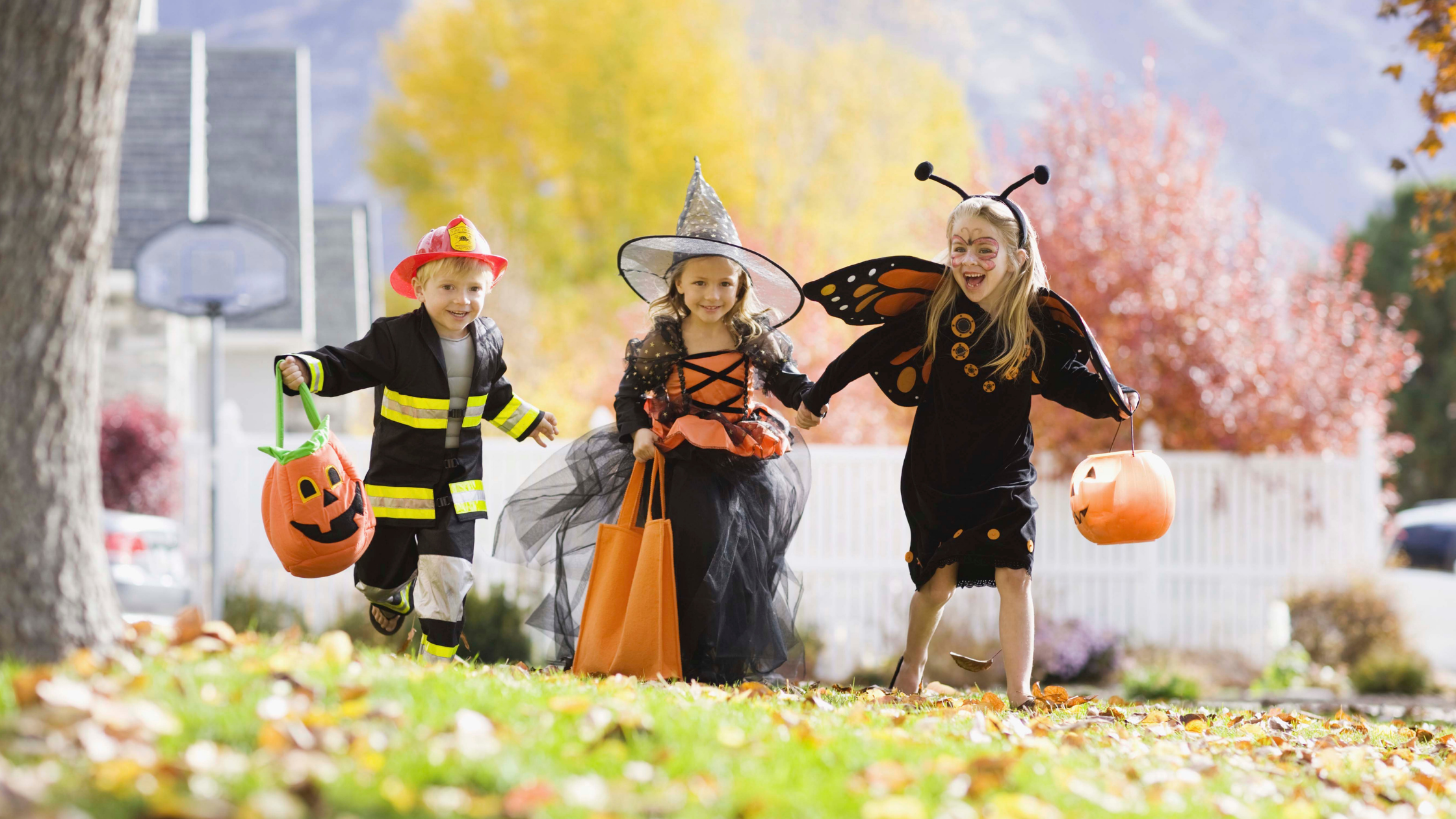 Children in Halloween costumes are on their way to a fall fundraising event.