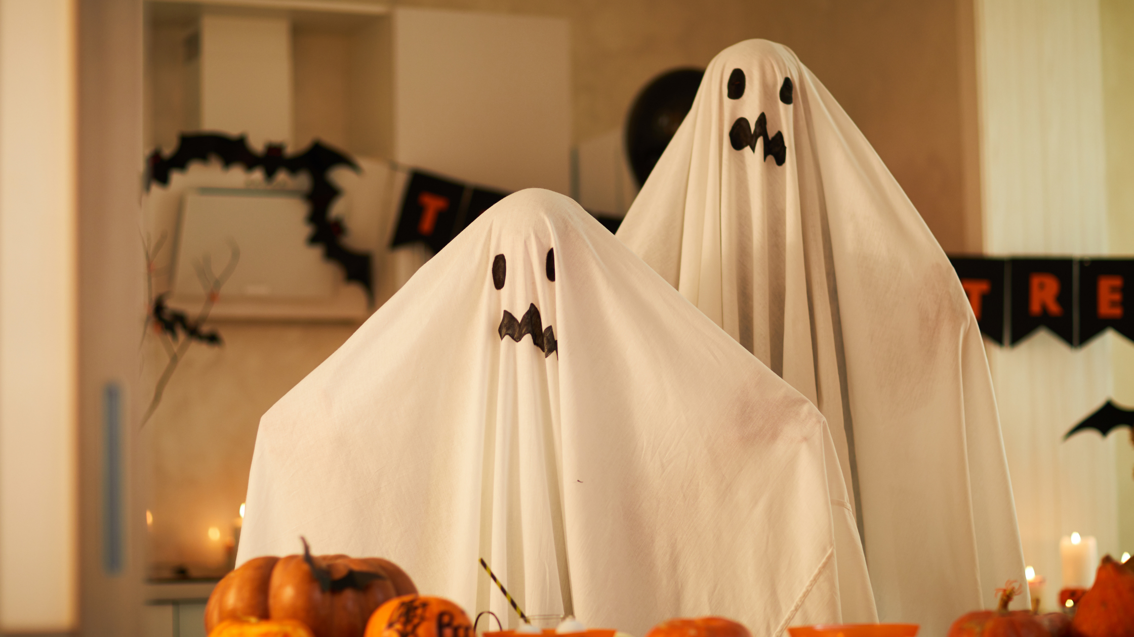 Two people dressed as ghosts to represent how donors can ghost nonprofits due to weak relationships.